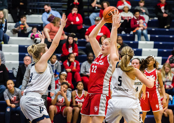 Jeffersonville's Britney Epperson hones in a long pass during their game against Providence on Tuesday. Staff Photo By Josh Hicks