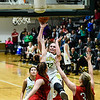 Floyd Central's Grace Hale draws a foul from the Evansville Harrison defense during the Highlanders' win over the Warriors on Friday. Staff photo by Tyler Stewart