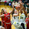 Floyd Central's Lindsey Dorsch pulls down the offensive rebound over the Evansville Harrison defense during the Highlanders' win over the Warriors on Friday. Staff photo by Tyler Stewart