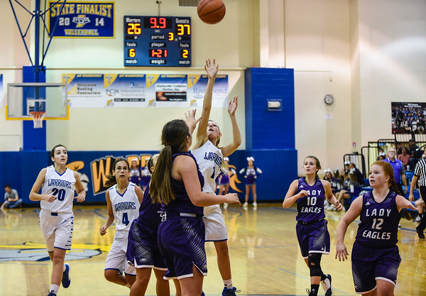 Christian Academy guard Danielle Summitt takes a shot over the Lanesville defenders during the Warriors' 48-46 loss to the Eagles on Thursday. Staff photo by Tyler Stewart
