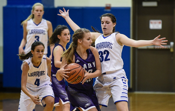 Christian Academy guard Hannah Beckley pressures Lanesville guard Carmen Jacobs during the Warriors' 48-46 loss to the Eagles on Thursday. Staff photo by Tyler Stewart