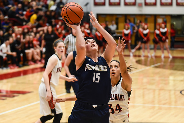 Providence guard Hannah Wolford beats the New Albany defense for a layup during the Pioneers' 61-50 loss to the Bulldogs on Friday. Staff photo by Tyler Stewart