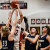 New Albany guard Earlean Davis pulls up for a shot over the Providence defenders during the Bulldogs'  61-50 win over the Pioneers on Friday. Staff photo by Tyler Stewart