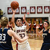 New Albany guard Earlean Davis drives into the Providence defenders for a shot during the Bulldogs'  61-50 win over the Pioneers on Friday. Staff photo by Tyler Stewart
