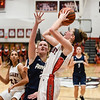 New Albany guard Julyen Condra takes the short-range shot over Providence forward Claire Rauck during the Bulldogs'  61-50 win over the Pioneers on Friday. Staff photo by Tyler Stewart