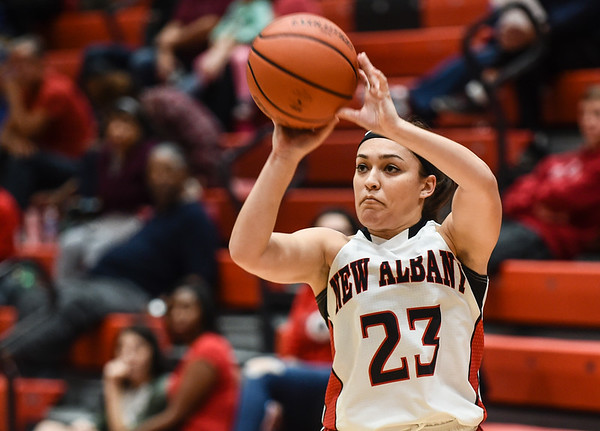 New Albany guard Marissa Jones pulls up for a 3-pointer during the Bulldogs'  61-50 win over Providence on Friday. Staff photo by Tyler Stewart