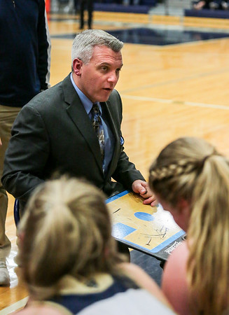 Providence's head coach Brad Burden draws out a diagram during the Pioneers' game against Clarksville at the Larkin Center on Friday. Staff Photo By Josh Hicks