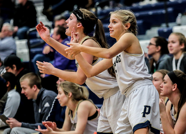 Providence's Brigid Welch, left, and Kaylee Kaiser celebrate a two-pointer during the Pioneers' game against the Clarksville at the Larkin Center on Friday. Staff Photo By Josh Hicks