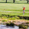 Silver Creek's Sydni Sorg hits her ball over a water hazard during the sectional at Old Capital Golf Course on Saturday.