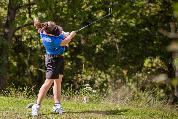 New Washington's Katie Lewis shoots down a steep hill during the sectional at Old Capital Golf Course on Saturday.