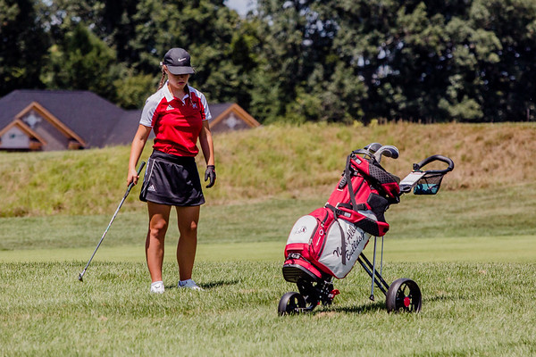 New Albany's Jessica Orr lines up her shot during the Zoeller Invitational at Champion's Pointe in Henryville on Saturday.