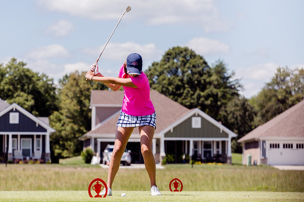 Providence's Jessica Hartledge tees off during the Zoeller Invitational at Champion's Pointe in Henryville on Saturday. Staff Photos By Josh Hicks