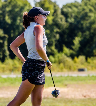 Floyd Central's Sydney Juliot watches her ball fall onto the fairway during the Zoeller Invitational at Champion's Pointe in Henryville on Saturday.