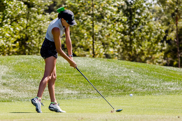 Providence's Emma Housz hits one out of the fairway during the Zoeller Invitational at Champion's Pointe in Henryville on Saturday.