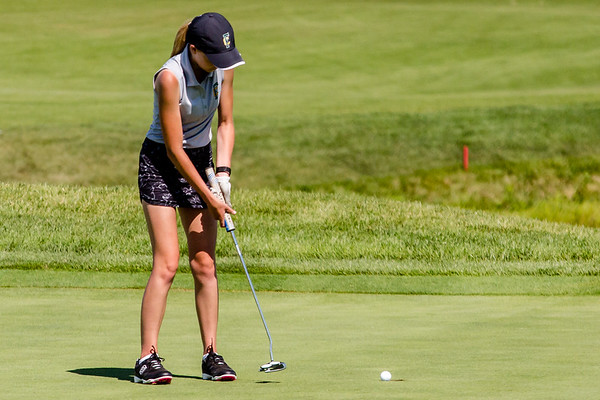 Floyd Central's Morgan Spanopoulos sinks a putt during the Zoeller Invitational at Champion's Pointe in Henryville on Saturday.