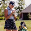 Floyd Central's Francesca Hartlage marks her score during the Zoeller Invitational at Champion's Pointe in Henryville on Saturday.