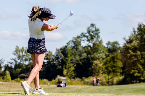 Corydon's Cami Schmitt takes a swing during the Zoeller Invitational at Champion's Pointe in Henryville on Saturday.