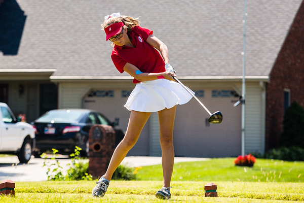 Jeffersonville's Bonnie Dixon keeps her head down as she follows through the ball during the Hoosier Hills Conference Championship at Elk Run.
