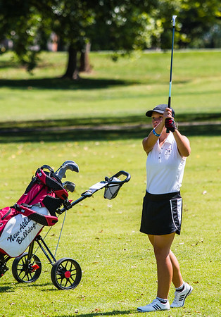 New Albany's Jessica Orr waits for her ball to hit the green during the Hoosier Hills Conference Championship at Elk Run.