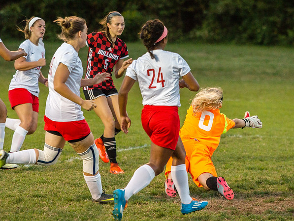New Albany's Laney Thompson scores a goal after beating several Jeffersonville defenders to the ball during the Bulldogs' game against the Red Devils at Jeffersonvile on Thursday. Staff Photos By Josh Hicks