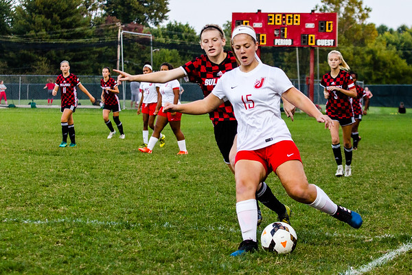 Jeffersonville's Kylee Luce clears the ball away from New Albany's Kat Walker during the Red Devils' game against the Bulldogs at Jeffersonvile on Thursday.