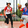 New Albany's Mariah Grant lands safely on first during the Bulldogs' New Albany Invitational championship game against Silver Creek on Saturday. Staff Photo By Josh Hicks