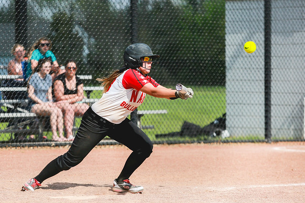 New Albany's Madison Lawson bunts the ball during the Bulldogs' New Albany Invitational championship game against Silver Creek on Saturday. Staff Photo By Josh Hicks