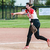 New Albany's Bri Schoenfeld throws a pitch during the Bulldogs' New Albany Invitational championship game against Silver Creek on Saturday. Staff Photo By Josh Hicks