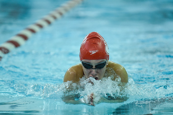 Jeffersonville's Adeline Dixon competes in the 100 yard breaststroke during the Red Devils' meet against Floyd Central on Thursday. Staff photo by Tyler Stewart