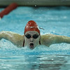 Jeffersonville's Sydney Sansbury competes in the 100 yard butterfly during the Red Devils' meet with Floyd Central on Thursday. Staff photo by Tyler Stewart