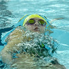 Floyd Central's Lauren Thompson competes in the 100 yard backstroke during the Highlanders' meet against Jeffersonville on Thursday. Staff photo by Tyler Stewart