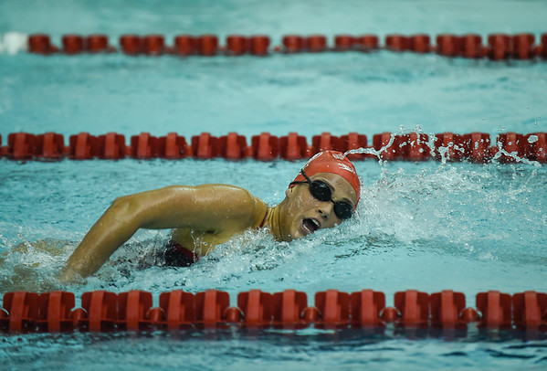 Jeffersonville's Rachel Walker pushes ahead of the competition during the 500 yard freestyle during the Red Devils' meet against Floyd Central on Thursday. Staff photo by Tyler Stewart