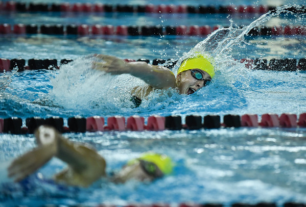 Floyd Central senior Kelsey Pinnick passes her opponent while competing in the 400 yard freestyle relay as part of the New Albany Relays Meet on Tuesday. Staff photo by Tyler Stewart