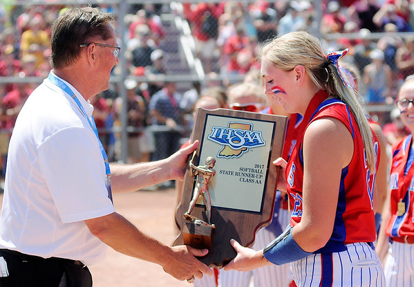 Don Knight | For The Herald Bulletin<br /> Elwood's Mackenzie Bryan accepts the the runner-up trophy for the Panthers after their 6-2 loss against Indianapolis Scecina in the Class 2A State Final at Ben Davis High School on Saturday.