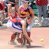 Don Knight | For The Herald Bulletin<br /> Scecina's Trinity Eckerty collides with Elwood catcher Madison Tincher in the Class 2A State Final at Ben Davis High School on Saturday.