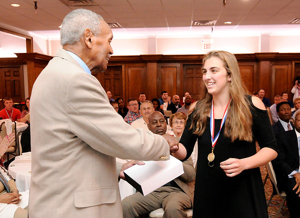 Don Knight | The Herald Bulletin<br /> Pendleton Heights' Sam Hammel receives the Johnny Wilson Award from Johnny Wilson at the Anderson Country Club on Wednesday.