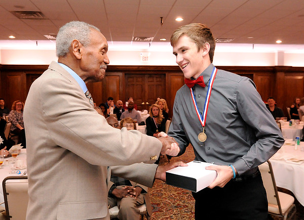 Don Knight   The Herald Bulletin<br /> Frankton's Landon Weins receives the Johnny Wilson Award from Johnny Wilson at the Anderson Country Club on Wednesday.
