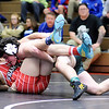 Don Knight |  The Herald Bulletin<br /> Pendleton Heights' Tremor Bynum wrestles Frankton's David Delph for the 195-pound title during the Madison County Wrestling Tournament at Anderson High School on Saturday.