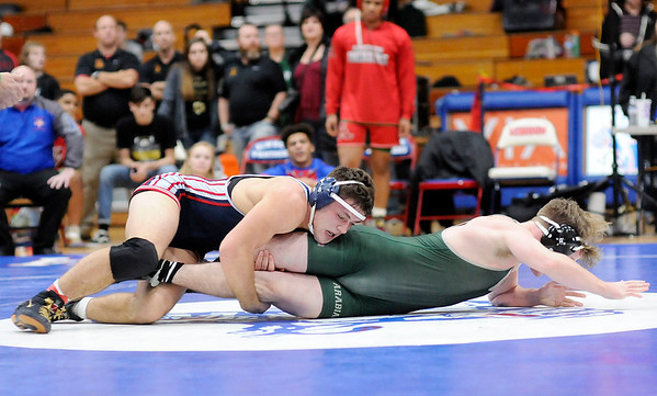 Don Knight | The Herald Bulletin Elwood's Jalen Morgan wrestles Pendleton Heights' Clayton Todd in the 182-pound final during the Madison County wrestling tournament at Elwood on Saturday.
