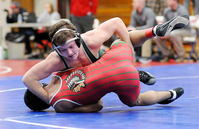 Don Knight | The Herald Bulletin Pendleton Heights' Caleb Gibson wrestles Anderson's Bryan Gaytan in the 145 pound championship.