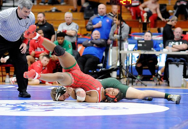 Don Knight | The Herald Bulletin<br /> Pendleton Heights' Jacob Fiew wins the 138-pound championship with a pin of Anderson's KD Williams in the Madison County tournament on Saturday.