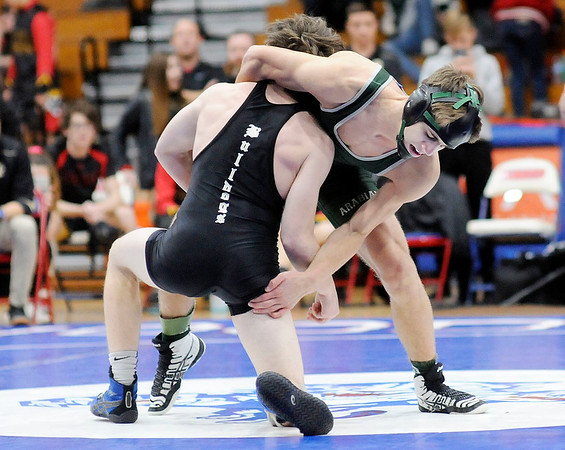Don Knight | The Herald Bulletin<br /> Pendleton Heights' Jared Brown wrestles Lapel's Harrison Hadley in the 126-pound final during the Madison County tournament on Saturday.
