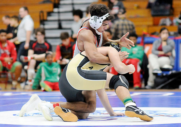 Don Knight   The Herald Bulletin<br /> Elwood's Trey Jordon wrestles  Madison-Grant's Jaren Glass in the 152-pound final during the Madison County wrestling tournament at Elwood on Saturday.