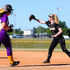 Henryville's Ashley Gerth gets an out at first base during the Hornet's 10-1 sectional champsionship win over Eastern on Thursday.