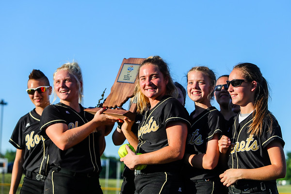 Henryville hoists their trophy after the Hornet's 10-1 sectional championship win over Eastern on Thursday. Staff Photos By Josh Hicks