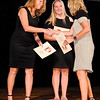 Don Knight | The Herald Bulletin<br /> Pendleton Heights cross country coach Melissa Hagerman, right, is congratulated by her fellow nominees Beth Sperry and Dylan Crosley after being named girls coach of the year during the THB Sports Awards at the Paramount on Tuesday.