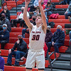 New Albany junior Jayden Thompson launches a three point basket during the Bulldogs' 71-70 loss to Blackford at the Doghouse on Tuesday. Photo by Joe Ullrich