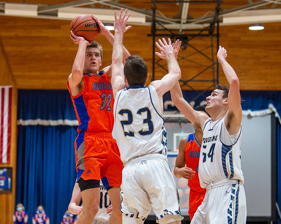 Silver Creek senior Kooper Jacobi pulls up for a jump shot during the Dragons' 62-41 victory over Providence in the 60th Annual Holiday Tournament held at Silver Creek on Tuesday. Photo by Joe Ullrich