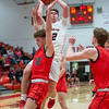 New Albany junior Tucker Biven drives to the basket during the Bulldogs' 71-70 loss to Blackford at the Doghouse on Tuesday. Photo by Joe Ullrich