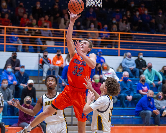 Silver Creek senior Kooper Jacobi finishes at the basket during the Dragons' 95-49 victory over Clarksville in the 60th Annual Holiday Tournament championship game held at Silver Creek on Wednesday. Photo by Joe Ullrich